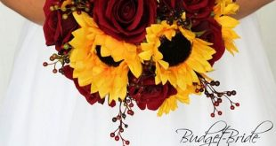 Sunflowers and dark red roses accented with red berries, perfect wedding flower ...
